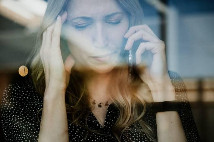 woman-on-the-phone-having-a-headache-6GDQ325-1.jpg